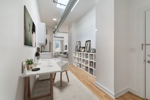Stunning 1 Bedroom Apartment W/Den Space!  Soaring High Ceilings, Central AC Units, Washer/Dryer In Unit, Shared Backyard!