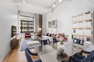 Light filled studio apartment with soaring ceilings, sleeping loft, and loads of storage space.
