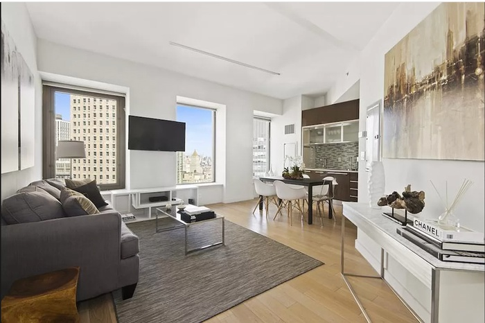 STUNNING CORNER UNIT ATOP THE 38TH FLOOR WITH CITY AND WATER VIEW