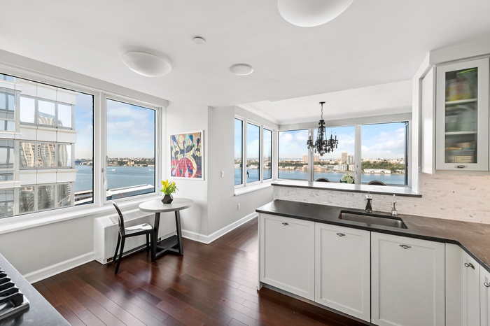 Stunning 3 Bed 3 Bath Residence with Open Kitchen & fascinating Hudson river & city views! Storage Included!