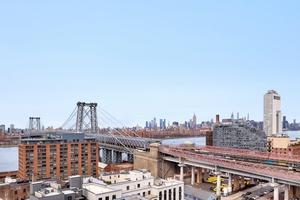 ICONIC WILLIAMSBURG LOFT WITH NYC SKYLINE & RIVER VIEWS