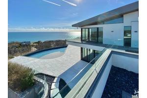 living In Modern Art Flying Over The Ocean $120,000/mo.