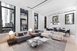 FLATIRON LOFT WITH ENDLESS POSSIBILITIES Seize the potential of this prewar loft featuring ten oversized windows and 12 ceilings with space to spare and volume galore.