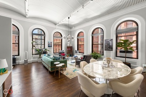 Welcome home to this stunning, sun drenched loft wrapped in nine oversized windows, offering picturesque city views to the south and west.