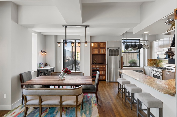 This one-of-a-kind triplex penthouse with private outdoor space is everything you're looking for!