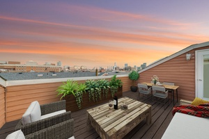 Beautiful Open and Spacious 2 Bedroom 1.5 Bathroom with Roofdeck and Wood Burning Fireplace located at the Grand Adams in Downtown Hoboken!