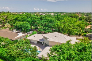 Two-story home with 5 bed/6 baths of 3,814 sqft , Coral Gables, Miami.