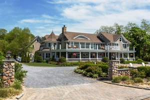 Stunning Waterfront Estate with NYC Skyline Views sits privately on 2+ acres