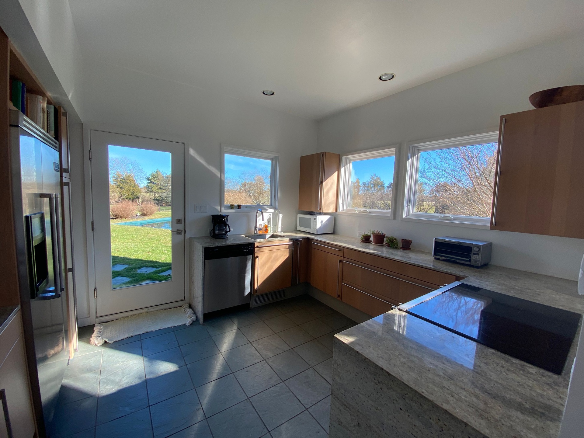 Wake up and Can you smell your coffee brewing- Kitchen with doors to the BBQ and Pool area