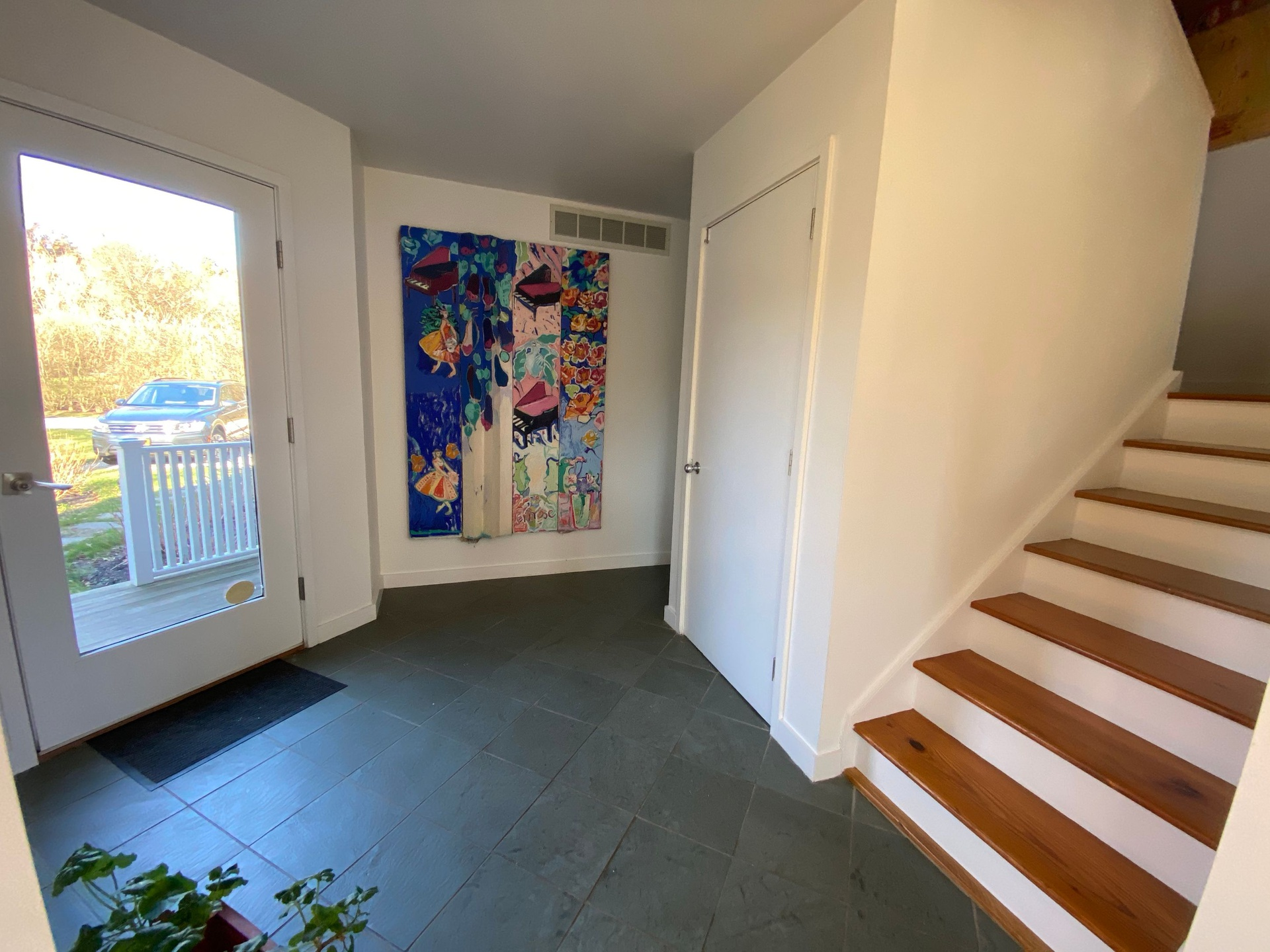 Entry Foyer with abundant storage and entrance to the lower level