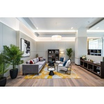A modern two-bedroom apartment set on the second floor of the luxury Garret Mansions development.