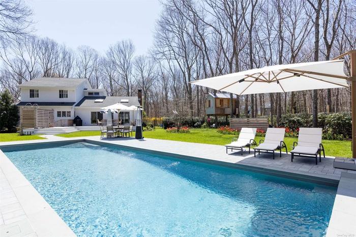 Gunite heated pool with patio surround